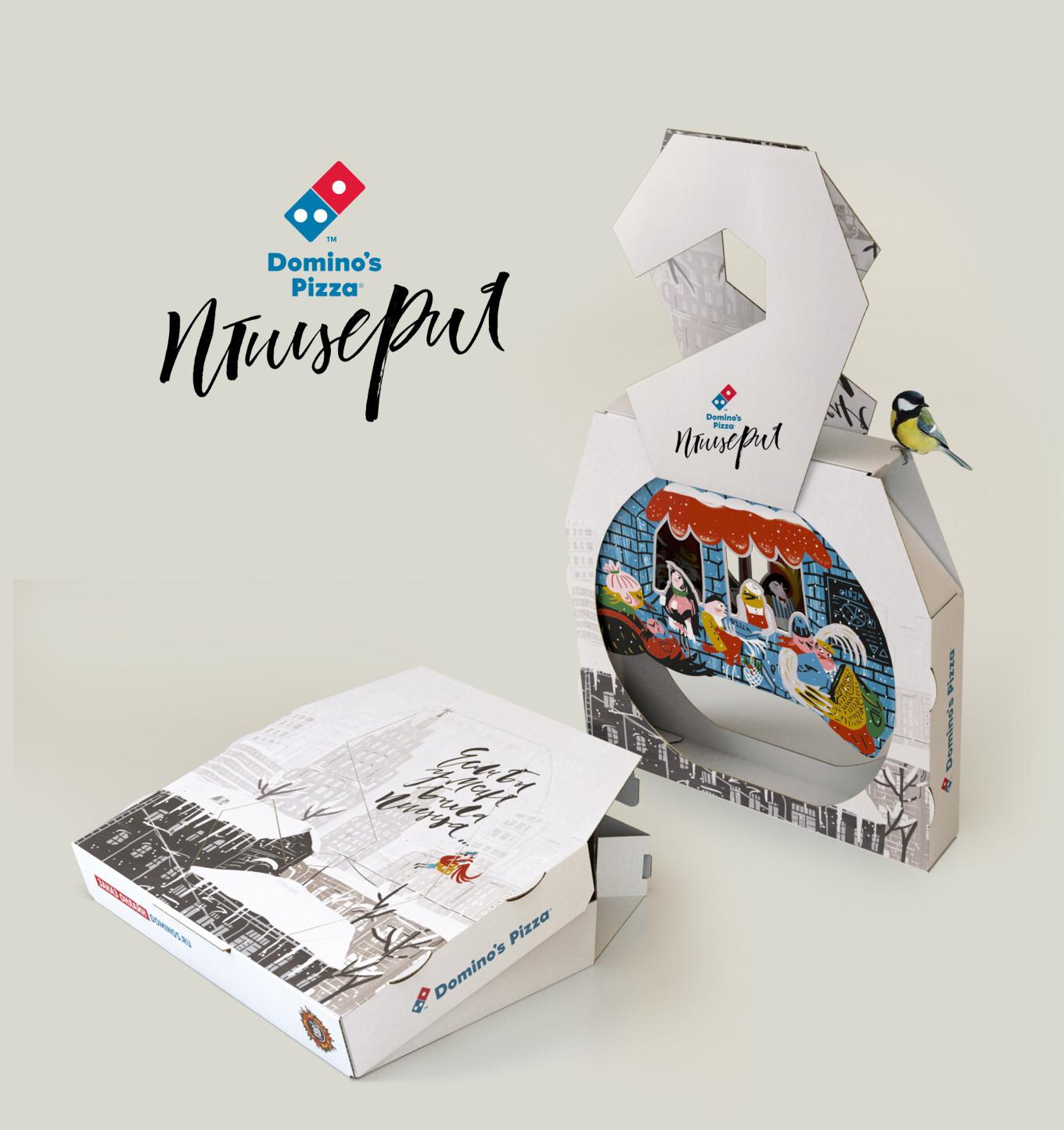 Domino's Pizza доставляет в Москве пиццу в коробках-кормушках для птиц