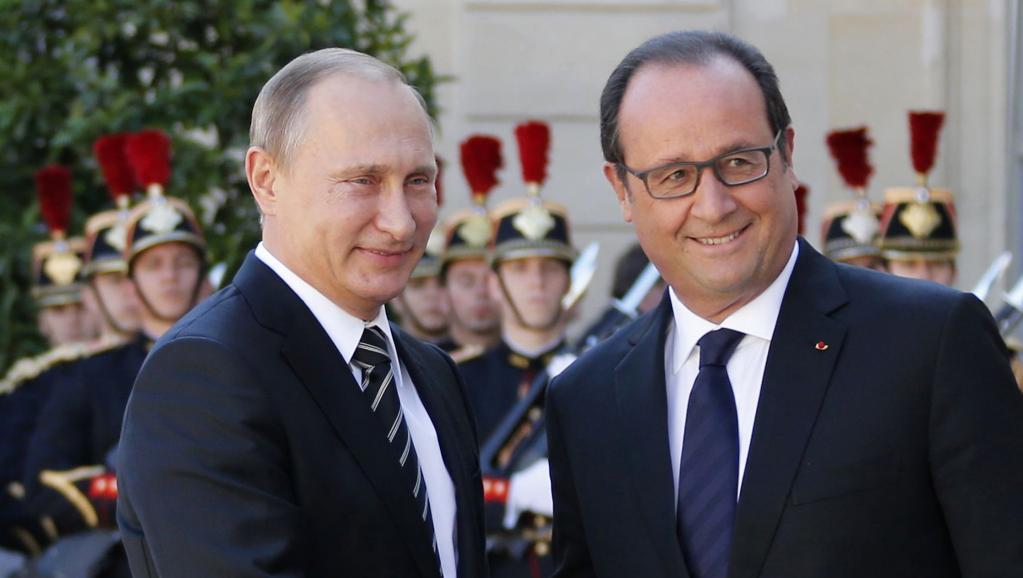 Олланд пригласил Путина на климатический саммит в Париж